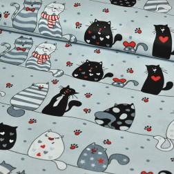 Barevné kočky na drátech na šedém podkladě